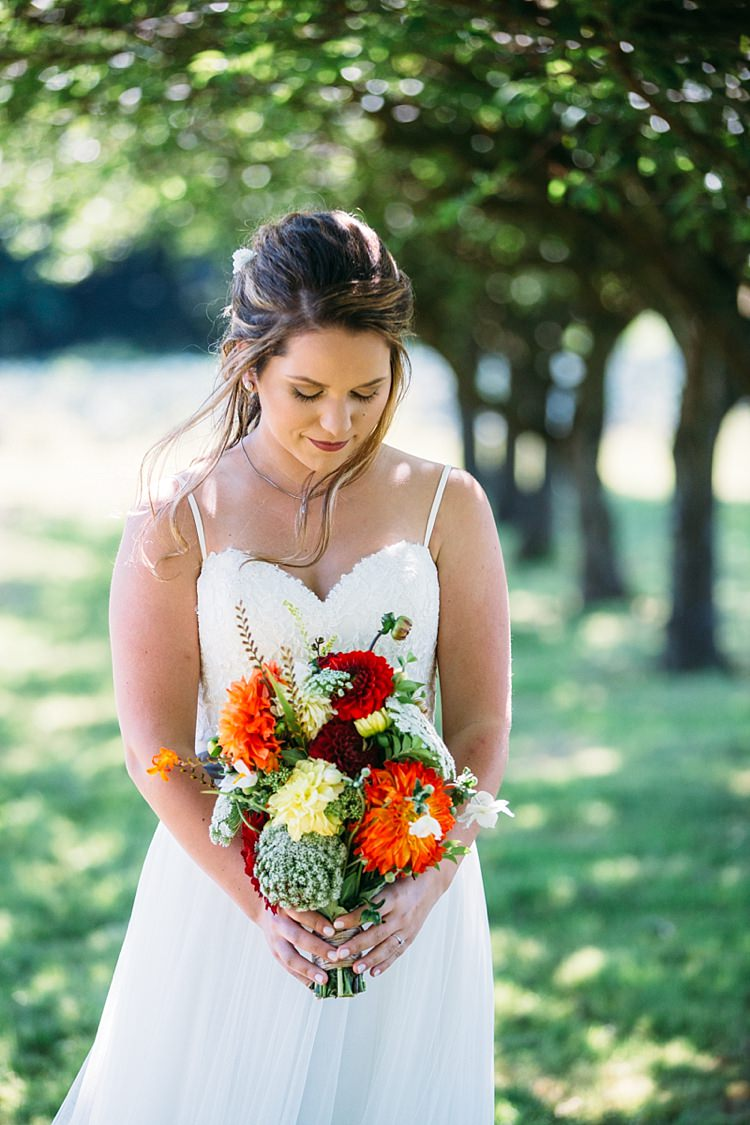 Bride Lace Tulle Bridal Gown Grey Sash Bright Bouquet Red Orange Yellow Florals Soft Hairstyle Organic Farm Wedding Washington http://www.katiedayphotos.com/