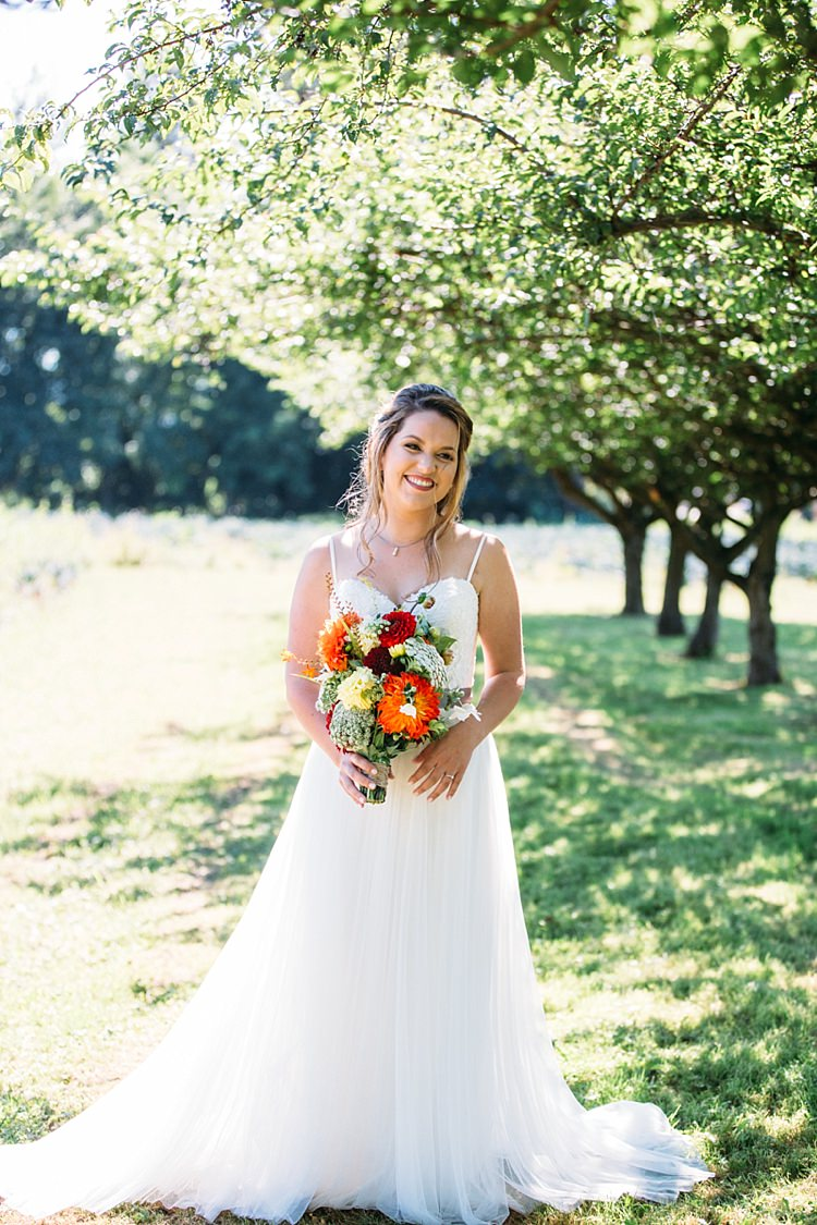 Bride Lace Tulle Bridal Gown Grey Sash Bright Orange Red Yellow Bouquet Loose Curls Hairstyle Trees Organic Farm Wedding Washington http://www.katiedayphotos.com/