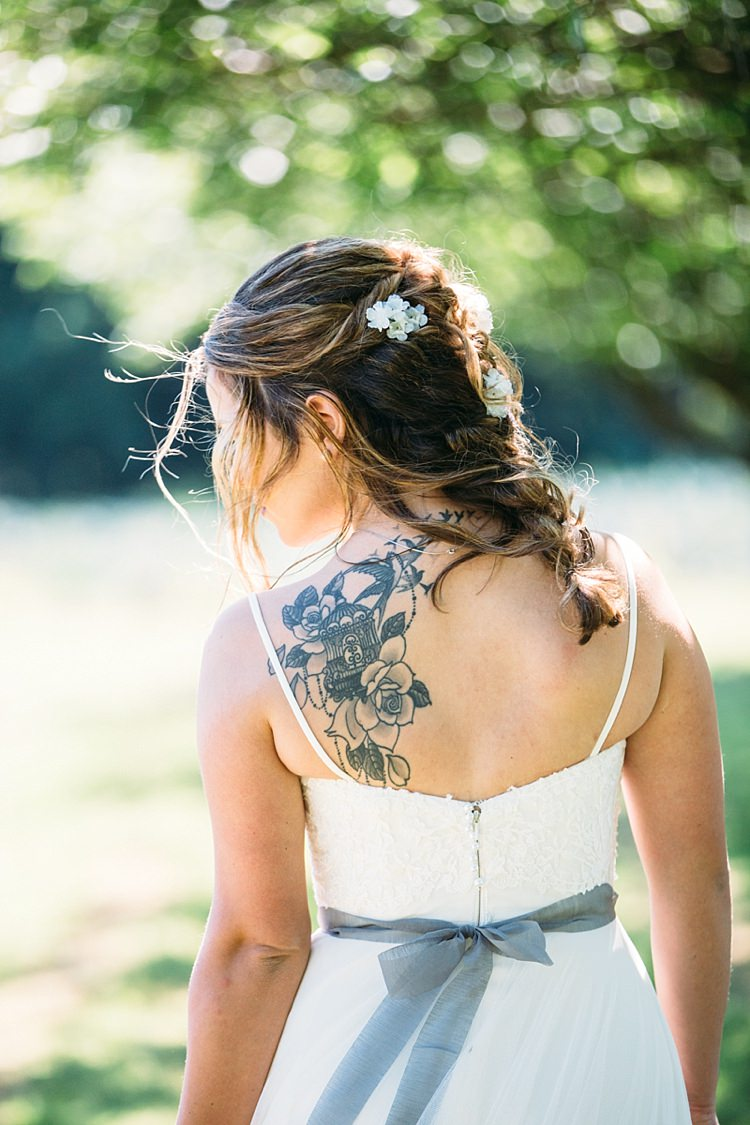 Bride Lace Tulle Bridal Gown Grey Sash Loose Curls Hairstyle White Flowers Back Tattoo Trees Organic Farm Wedding Washington http://www.katiedayphotos.com/