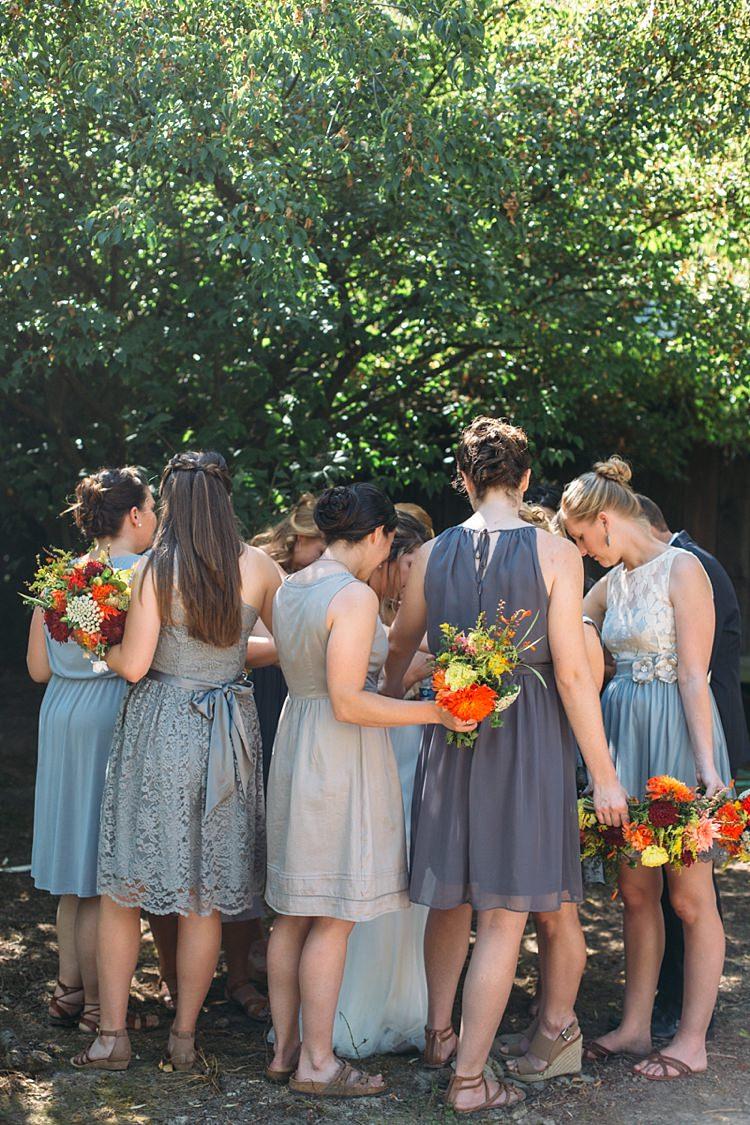 Bride Bridesmaids Grey Blue Dresses Bright Orange Red Yellow Bouquets Organic Farm Wedding Washington http://www.katiedayphotos.com/