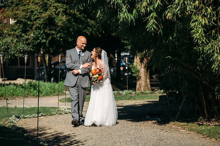 Outdoor Ceremony Bride Lace Tulle Bridal Gown Grey Sash Veil Bright Orange Red Yellow Bouquet Father Laughs Organic Farm Wedding Washington http://www.katiedayphotos.com/