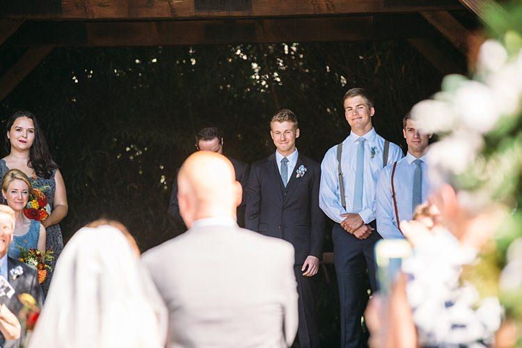 Outdoor Ceremony Bride Entrance Groom Navy Blue Suit Grey Tie Groomsmen Bridesmaids Organic Farm Wedding Washington http://www.katiedayphotos.com/