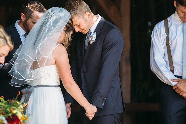 Outdoor Ceremony Bride Lace Tulle Bridal Gown Grey Sash Veil Groom Navy Blue Suit Grey Tie Floral Button Hole Organic Farm Wedding Washington http://www.katiedayphotos.com/