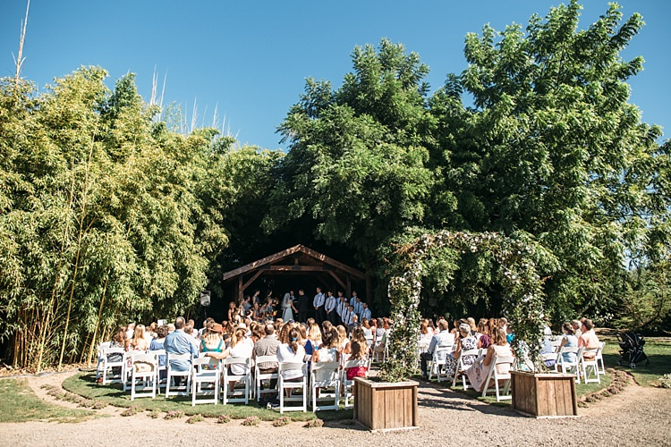 Outdoor Ceremony Floral Greenery Archway Bridal Party Guests Leafy Trees Organic Farm Wedding Washington http://www.katiedayphotos.com/