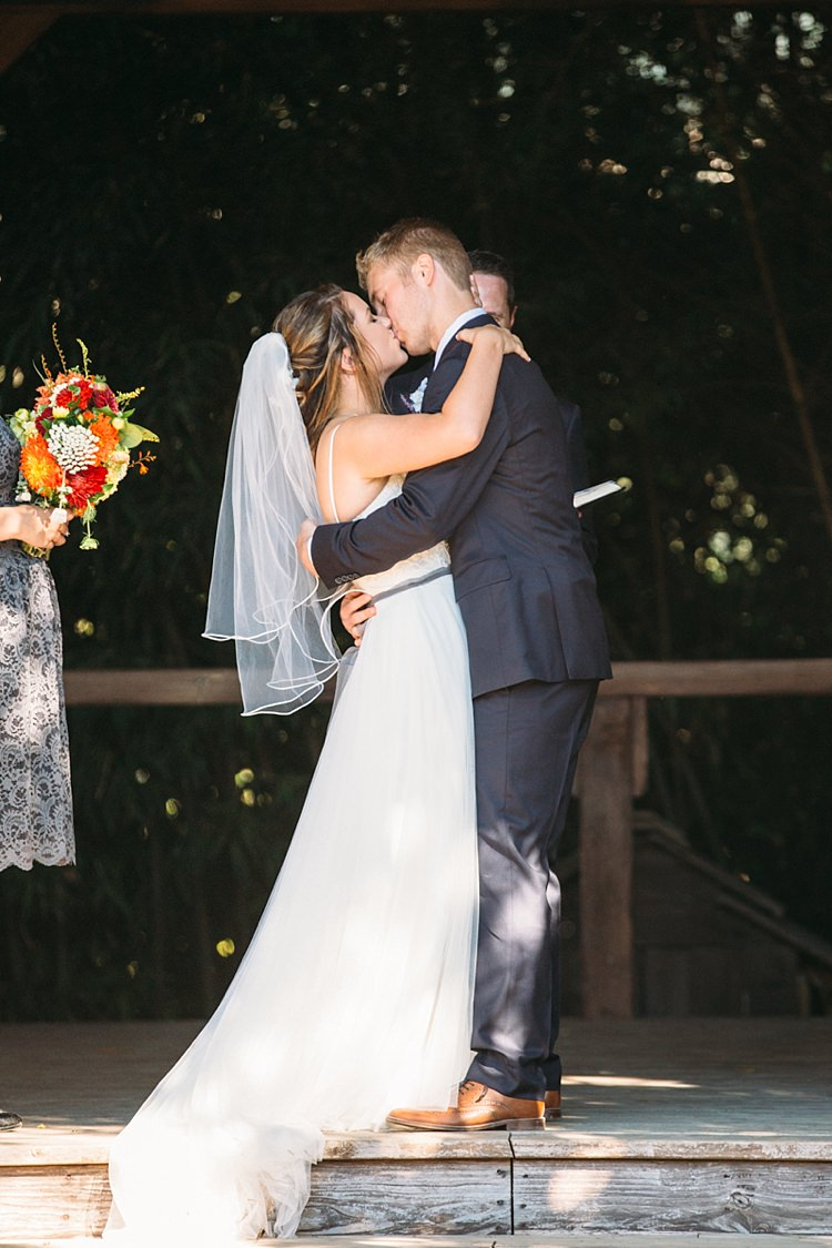 Outdoor Ceremony Bride Lace Tulle Bridal Gown Grey Sash Veil Groom Navy Blue Suit Grey Tie Floral Button Hole Kiss Organic Farm Wedding Washington http://www.katiedayphotos.com/