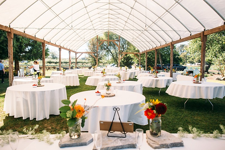 Outdoor Reception Marquee Round Tables Bright Florals Glass Vases Organic Farm Wedding Washington http://www.katiedayphotos.com/