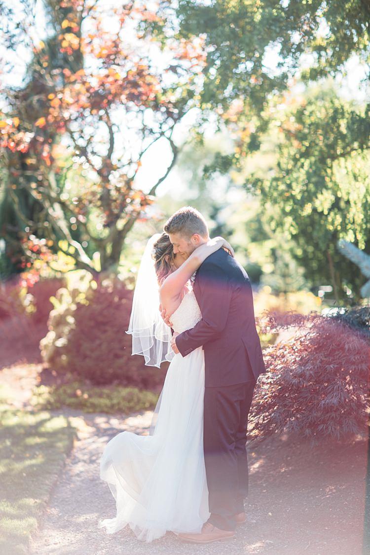 Bride Lace Tulle Bridal Gown Grey Sash Groom Navy Blue Suit Grey Tie Hugs Organic Farm Wedding Washington http://www.katiedayphotos.com/