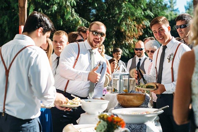 Groomsmen White Shirts Ties Suspenders Reception Food Table Thumbs Up Organic Farm Wedding Washington http://www.katiedayphotos.com/
