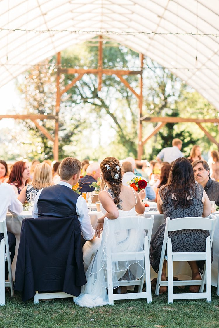 Outdoor Reception Marquee Bride Lace Tulle Bridal Gown Grey Sash Loose Curls Hairstyle Flowers Groom Navy Blue Suit Vest Guests White Chairs Organic Farm Wedding Washington http://www.katiedayphotos.com/