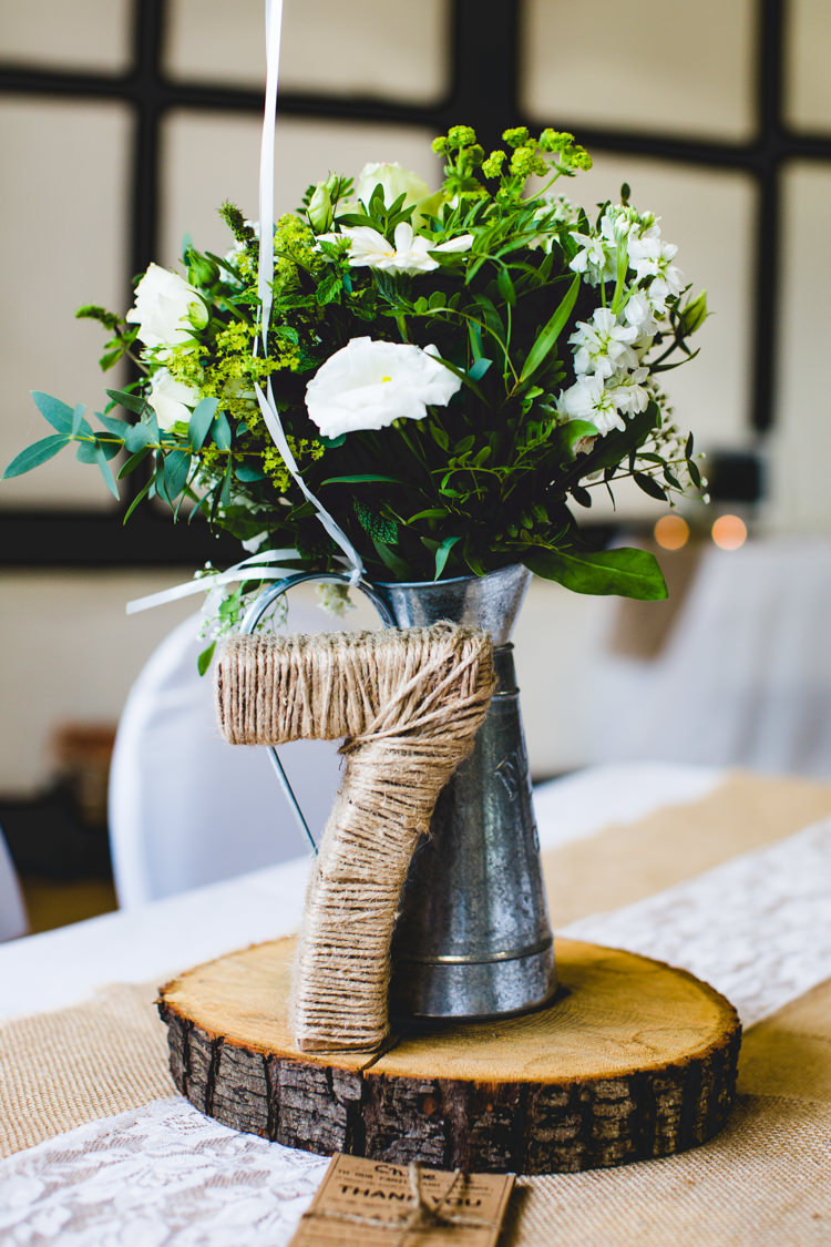 White Jug Flowers Log Slice Twine Table Number Decor Stylish Relaxed Fun White Wedding http://www.livvy-hukins.co.uk/