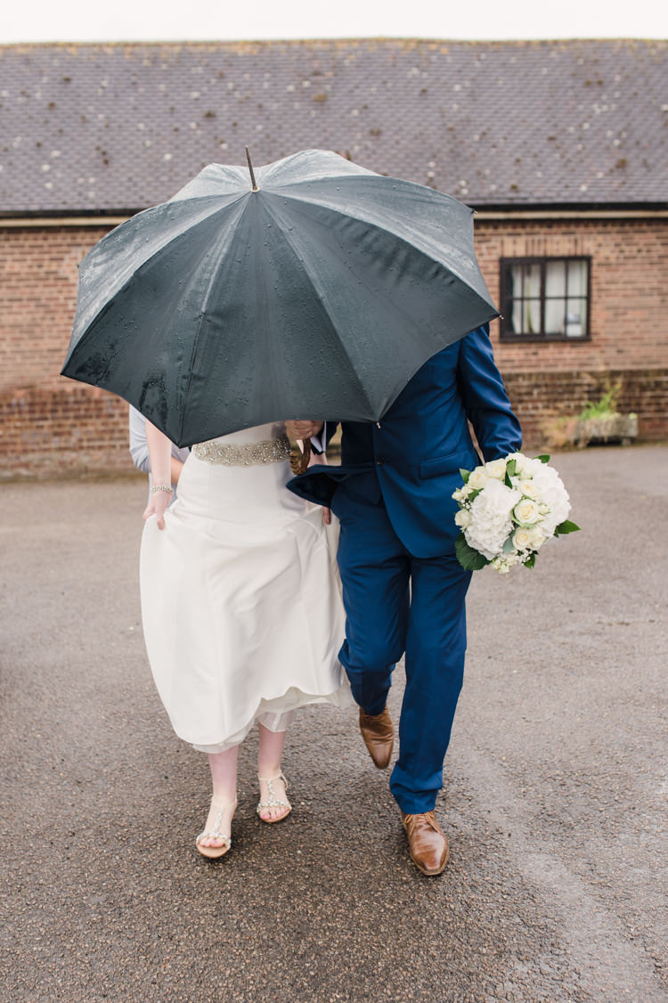 Rainy Umbrella Simple Elegant Pretty Barn Wedding http://www.fayecornhillphotography.co.uk/