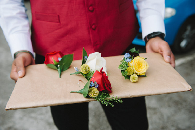 Buttonholes Roses Red Yellow Artistic Creative Colourful Farm Wedding http://www.mustardyellowphotography.com/