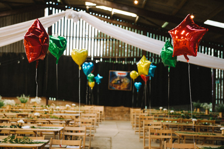 Balloons Aisle Stars Hearts Artistic Creative Colourful Farm Wedding http://www.mustardyellowphotography.com/