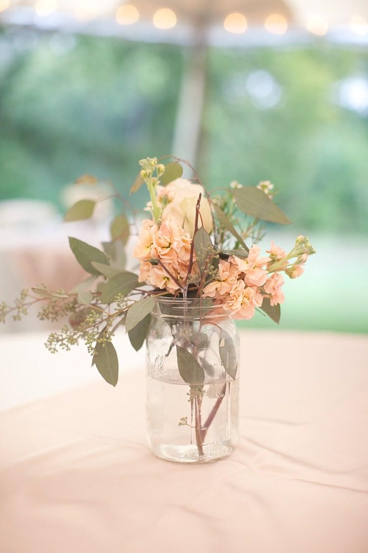 Reception Glass Jar Fresh Cream Peach Florals Tables Fairy Lights Gold & Peach Riverside Garden Wedding http://kellyhornberger.com/