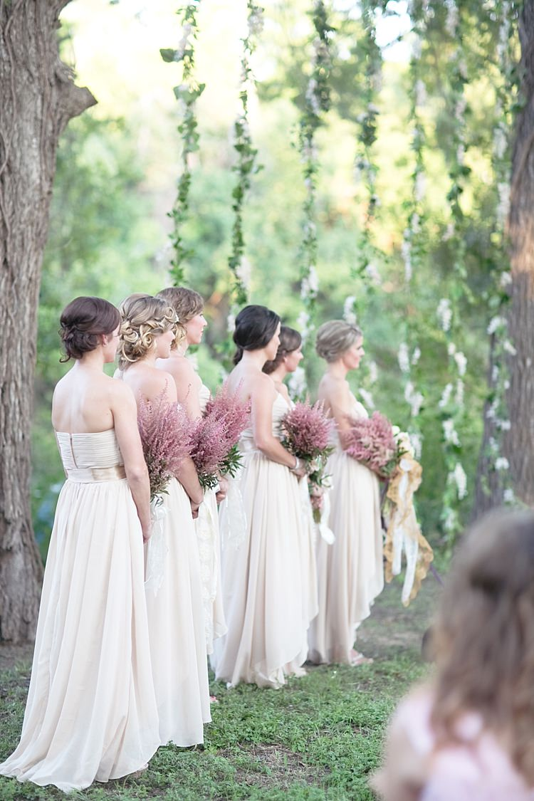 Outdoor Ceremony Bridesmaids Cream Sweetheart Dresses Embellished Sashes Pink Bouquets Long Ribbons Hanging Floral Décor Gold & Peach Riverside Garden Wedding http://kellyhornberger.com/
