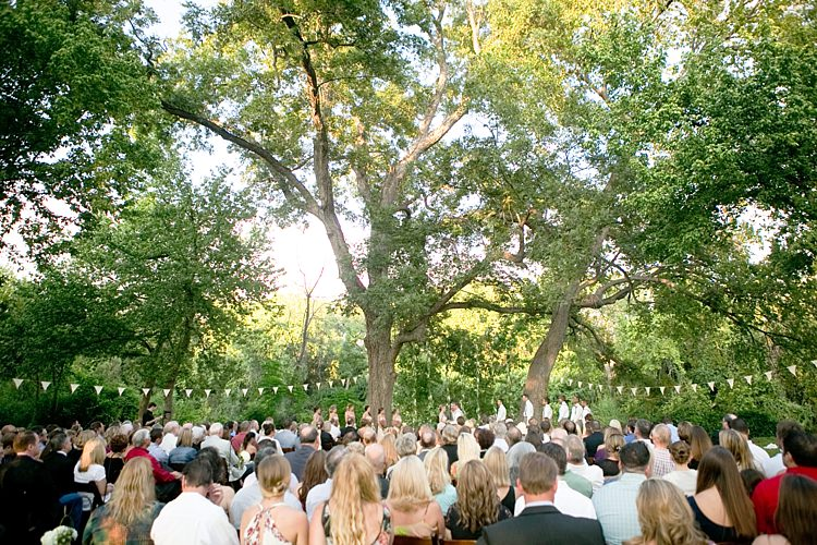 Outdoor Ceremony Bride Groom Bridal Party Hanging Floral Décor Bunting Trees Guests Gold & Peach Riverside Garden Wedding http://kellyhornberger.com/