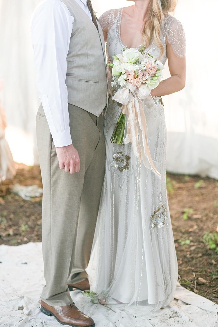Bride Beaded Jenny Packham Bridal Gown Cream Peach Bouquet Roses Carnations Long Ribbons Groom Khaki Pants Vest Brown Tie Gold & Peach Riverside Garden Wedding http://kellyhornberger.com/