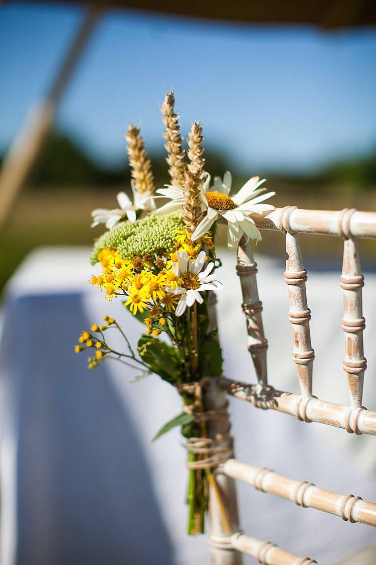 Daisy Wheat Chair Aisle Pew End Flowers Pretty Outdoorsy Yellow Tipi Wedding http://www.binkynixon.com/