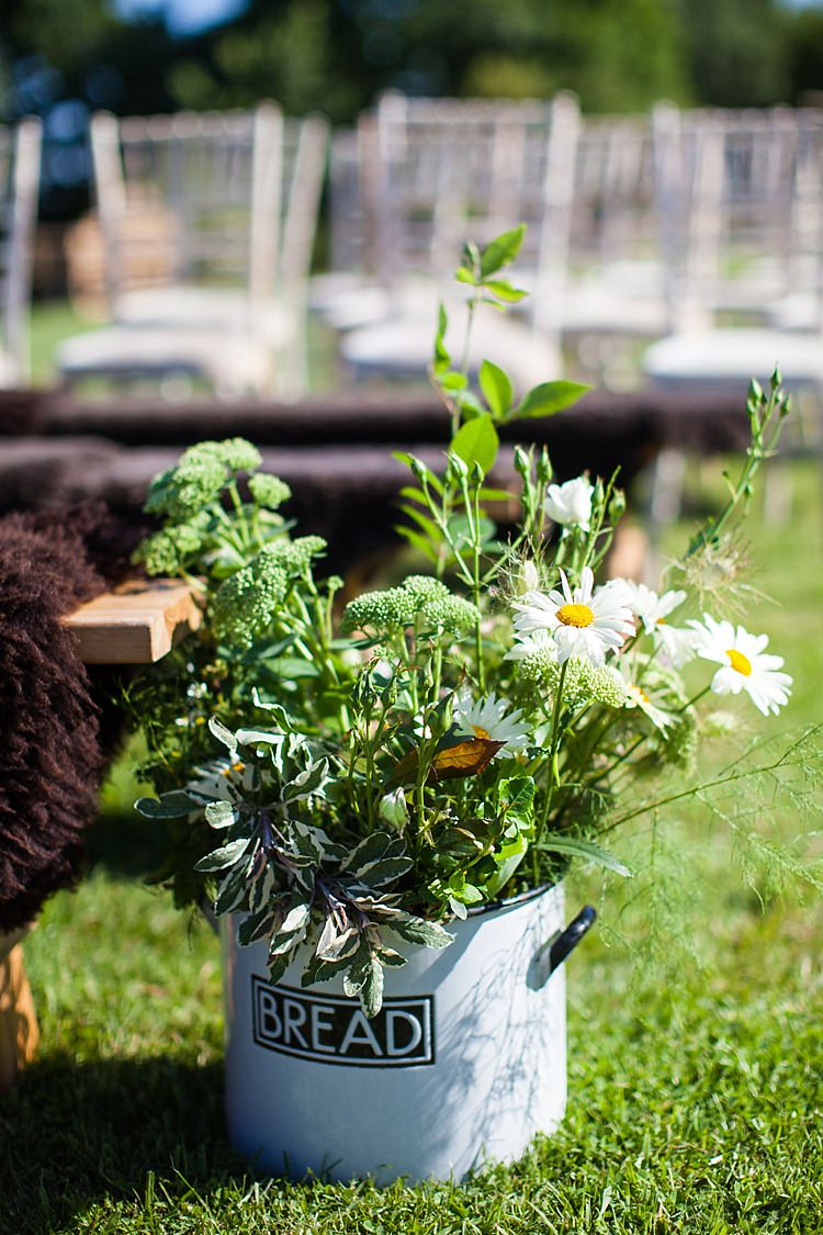 Bread Tin Flowers Aisle Decor Foliage WIld Pretty Outdoorsy Yellow Tipi Wedding http://www.binkynixon.com/