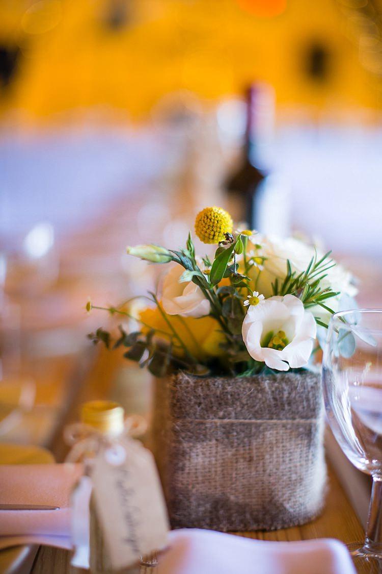Hessian Burlap Flowers Centrepiece Decor Tables Pretty Outdoorsy Yellow Tipi Wedding http://www.binkynixon.com/