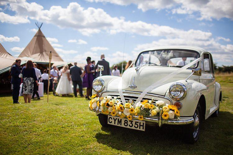 Moris Minor Car Flowers Pretty Outdoorsy Yellow Tipi Wedding http://www.binkynixon.com/