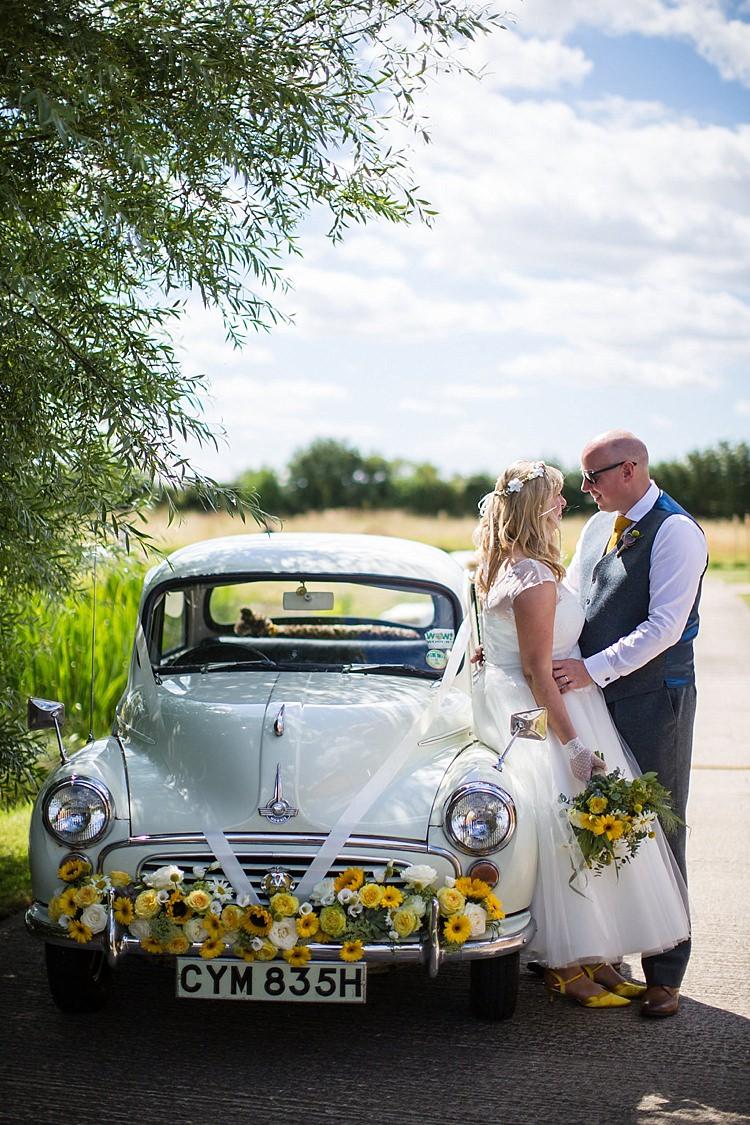 Morris Minor Car Flowers Pretty Outdoorsy Yellow Tipi Wedding http://www.binkynixon.com/