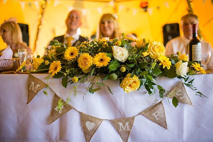 Top Table Flowers Bunting Pretty Outdoorsy Yellow Tipi Wedding http://www.binkynixon.com/