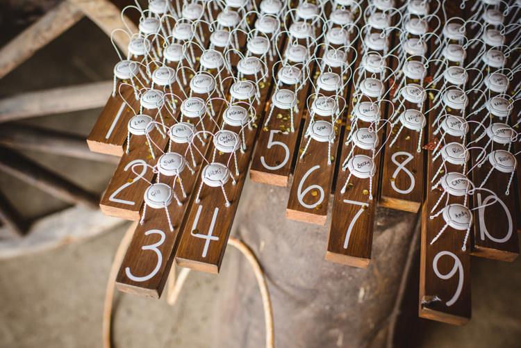 Seating Table Plan Bottle Tops Rustic Wooden Magical Fun Outdoor Barn Wedding http://www.sophieduckworthphotography.com/
