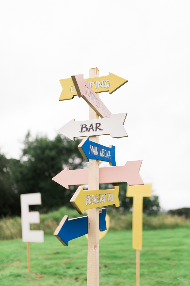 Painted Wooden Sign Post Yellow Blue Camping Festival Rave Tipi Wedding http://petalandblushartistry.co.uk/