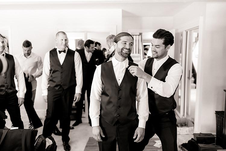 Groom White Shirt Black Vest Groomsmen Ceremony Preparation Luxe Outdoor Garden Wedding in California http://figlewiczphotography.com/