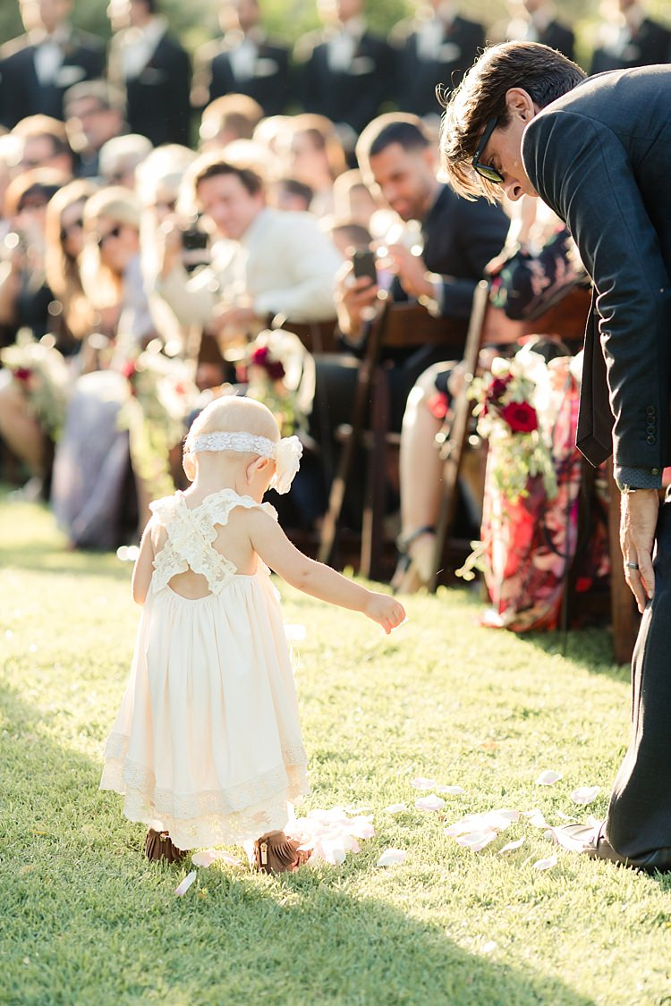 Outdoor Ceremony Flowergirl White Lace Dress Flower Headband Petals Guests Wooden Chairs Fresh Florals Luxe Outdoor Garden Wedding in California http://figlewiczphotography.com/