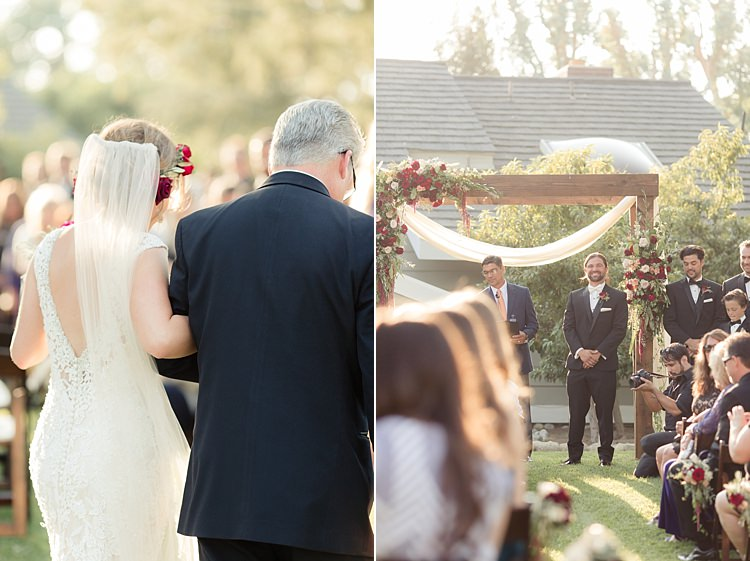 Outdoor Ceremony Bride Entrance Father Groom Decorated Wooden Arch Red Maroon Cream Roses Amaranth Guests Luxe Outdoor Garden Wedding in California http://figlewiczphotography.com/