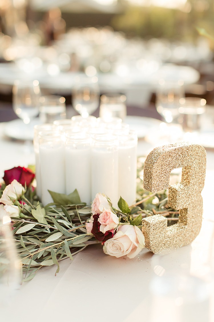Outdoor Ceremony Fresh Floral Centrepiece Red Pink Cream Roses Candles Gold Glitter Table Number Luxe Outdoor Garden Wedding in California http://figlewiczphotography.com/