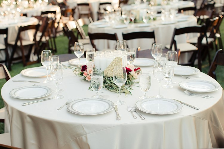 Outdoor Reception Fresh Floral Centrepiece Pink Red Cream Roses Candles Gold Glitter Table Number Luxe Outdoor Garden Wedding in California http://figlewiczphotography.com/