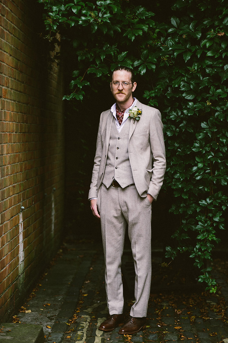 Groom Grey Suit Cravat Glasses Small Vintage City Wedding http://www.sarahlondonphotography.co.uk/