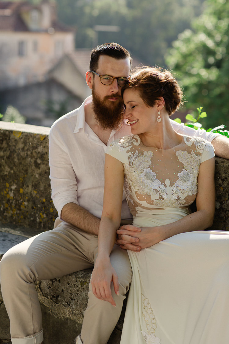 Bride Lace Illusion Back Bridal Gown Groom Glasses Khaki Pants White Shirt Stone Seat Homely Vintage Villa Wedding Portugal http://www.mattandlenaphotography.com/