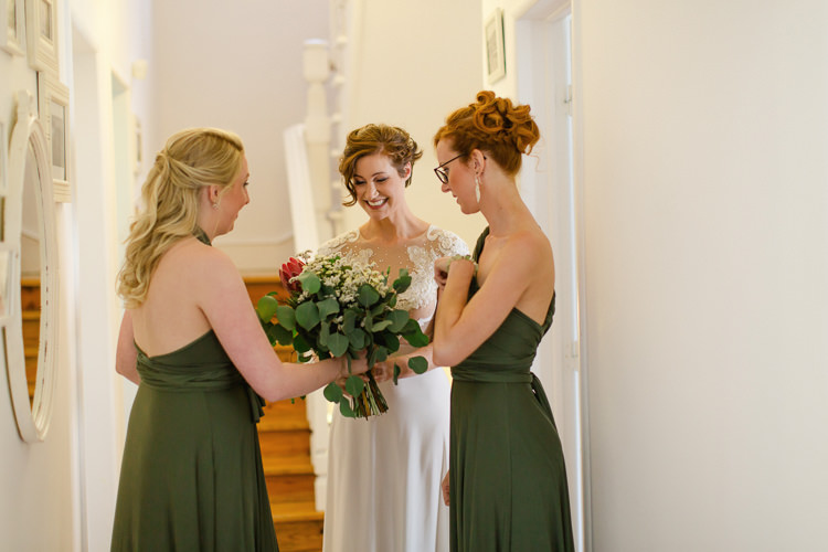 Bride Lace Illusion Back Bridal Gown Bridesmaids Dark Green Dresses Bouquet Red Proteas Daises Florals Homely Vintage Villa Wedding Portugal http://www.mattandlenaphotography.com/
