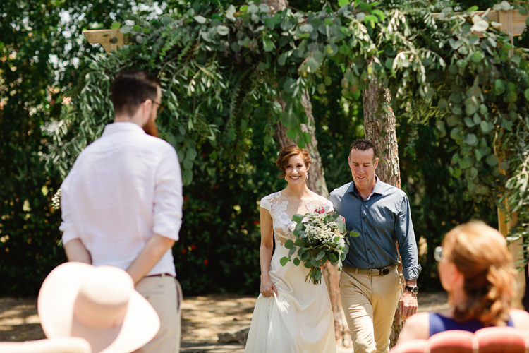 Outdoor Ceremony Bride Lace Illusion Back Bridal Gown Bouquet Red Proteas Daises Father Entrance Groom Homely Vintage Villa Wedding Portugal http://www.mattandlenaphotography.com/