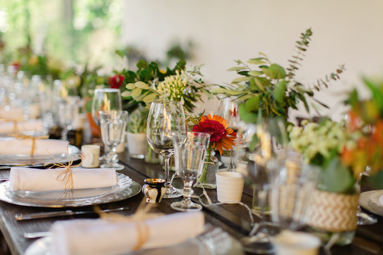 Reception Wooden Table Fresh Multicoloured Florals Glass Vases Potted Succulents Homely Vintage Villa Wedding Portugal http://www.mattandlenaphotography.com/