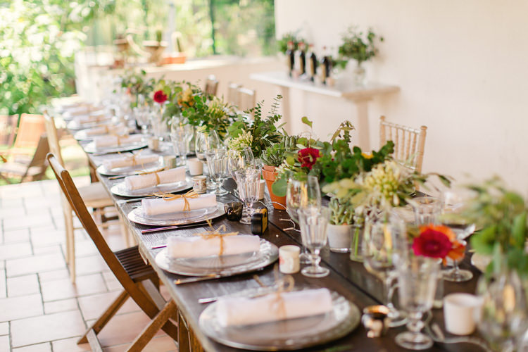 Reception Wooden Table Assorted Wooden Chairs Fresh Multicoloured Florals Glass Vases Potted Succulents Homely Vintage Villa Wedding Portugal http://www.mattandlenaphotography.com/
