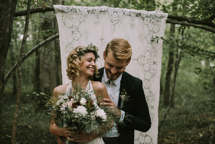 Bride Lace Halter-Neck Bridal Gown Floral Crown White Maroon Blush Bouquet Groom Black Jacket White Polka Dot Shirt Hanging Lace Décor Organic Woodland Elopement Wedding Ideas http://www.miraalpajarito.es/