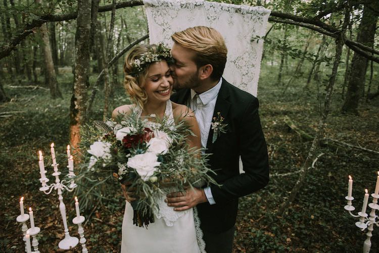 Bride Lace Halter-Neck Bridal Gown Floral Crown White Maroon Blush Bouquet Groom Black Jacket White Polka Dot Shirt Hanging Lace Décor Candlesticks Organic Woodland Elopement Wedding Ideas http://www.miraalpajarito.es/