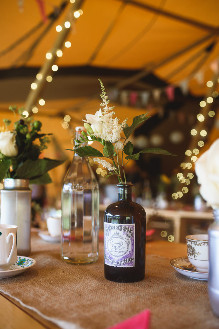 Gin Bottle Flowers Decor Centrepiece Colourful Outdoorsy Festival Tipi Wedding http://www.jacksonandcophotography.com/