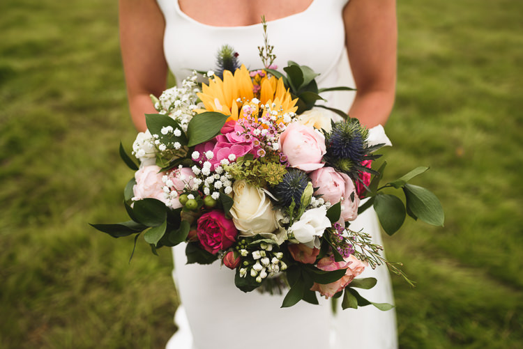 Bouquet Flowers Bride Bridal Sunflower Peony Gypsophila Colourful Outdoorsy Festival Tipi Wedding http://www.jacksonandcophotography.com/