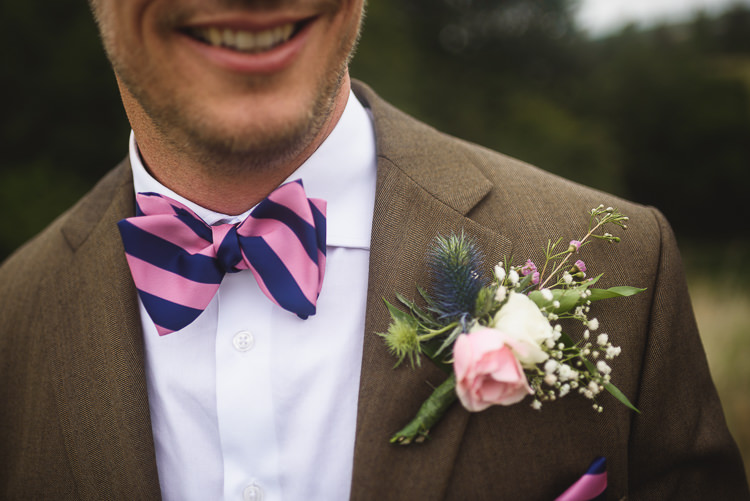 Bow Tie Groom Thistle Buttonhole Colourful Outdoorsy Festival Tipi Wedding http://www.jacksonandcophotography.com/