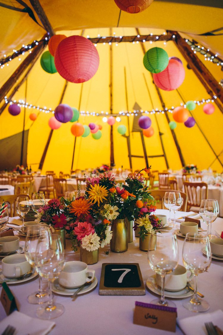 Flowers Gold Jars Bottles Centrepiece Table Decor Lanterns Fairy Lights Colourful Outdoorsy Tipi Wedding http://amybphotography.co.uk/