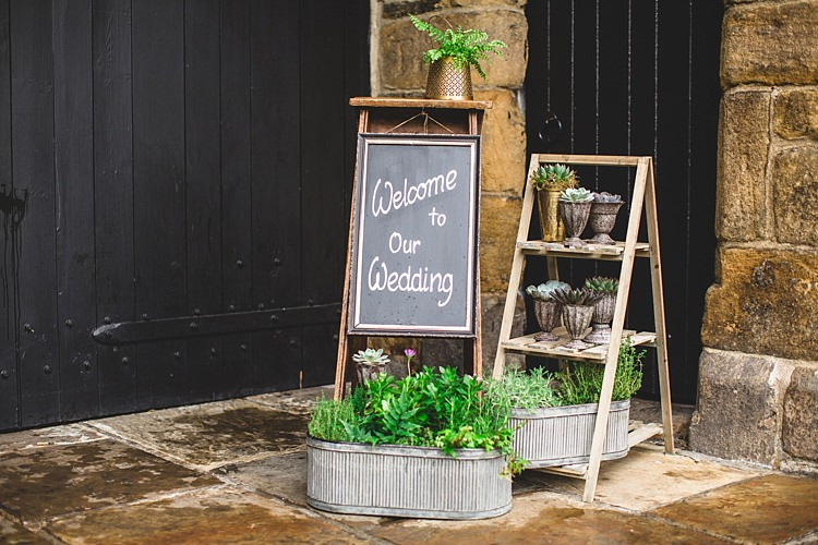 Welcome Sign Black Board Ladder Decor Eclectic Foliage Edison Lights Wedding http://www.tobiahtayo.com/