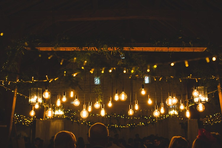 Eclectic Foliage Edison Lights Lighting Barn Wedding http://www.tobiahtayo.com/