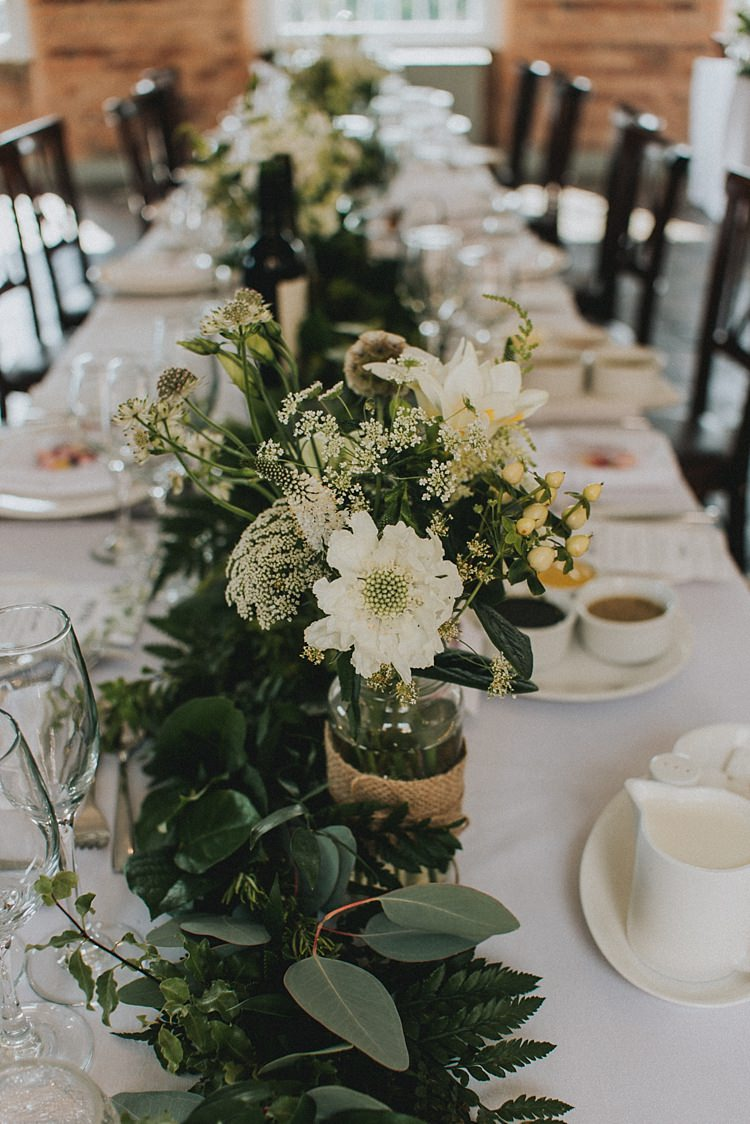wedding table decorations flowers industrial cool greenery filled playful mill wedding 1179