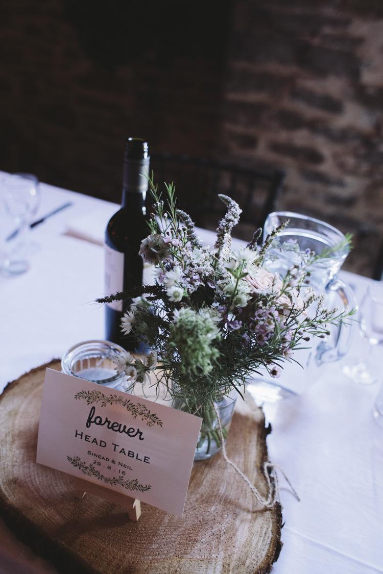 Centrepiece Log Flowers Jar Decor Rustic Quintessentially English Countryside Wedding http://www.sarahmorris-photography.com/